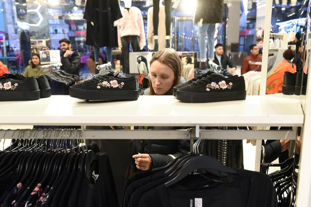 FILE PHOTO: A woman shops at an H&M store in New York City, U.S. December 23, 2017. REUTERS/Stephanie Keith/File Photo
