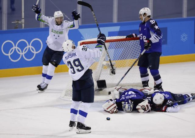 Ice Hockey – Pyeongchang 2018 Winter Olympics – Men Preliminary Round Match - U.S. v Slovenia - Kwandong Hockey Centre, Gangneung, South Korea – February 14, 2018 -  Jan Mursak (39) of Slovenia celebrates scoring on Team USA's Ryan Zapolski in overtime. REUTERS/David W Cerny