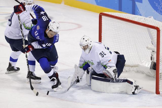 REFILE - CORRECTING SLUG Ice Hockey – Pyeongchang 2018 Winter Olympics – Men Preliminary Round Match - U.S. v Slovenia - Kwandong Hockey Centre, Gangneung, South Korea – February 14, 2018 - Jordan Greenway (18) of the U.S. in action near the Slovenia net. REUTERS/David W Cerny