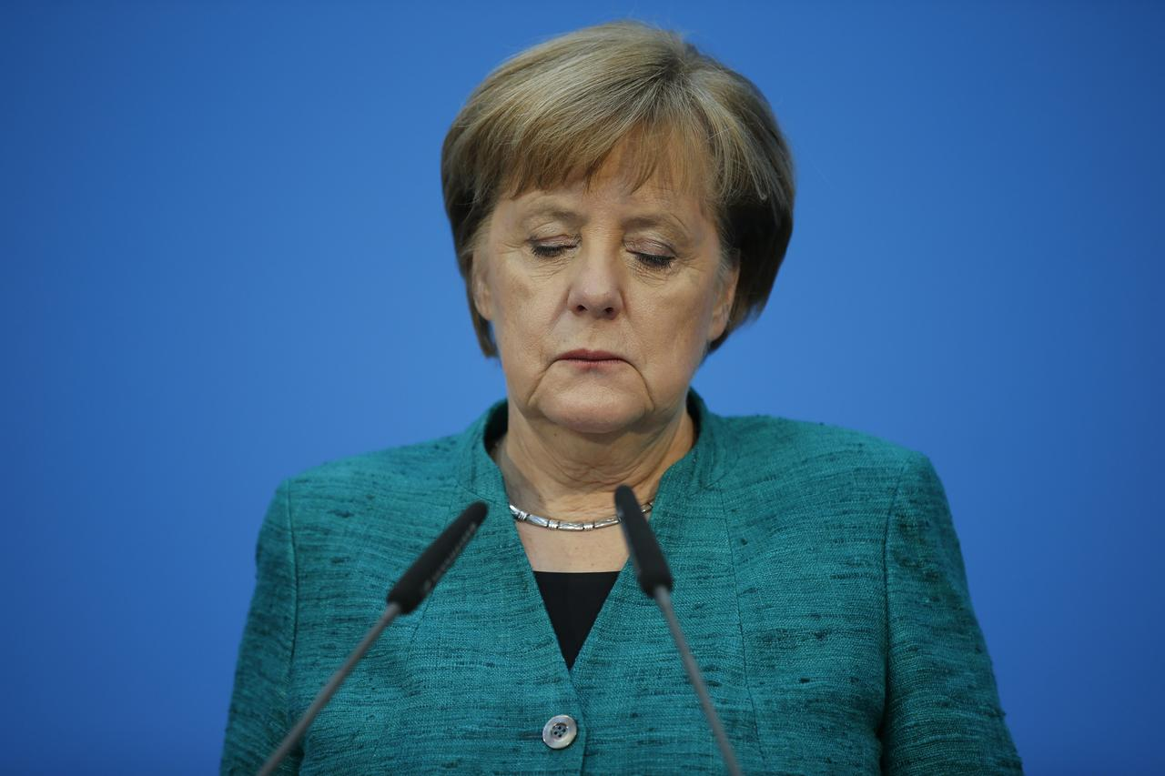 Image result for Merkel's Bavarian allies warn SPD to stick to deal on migrants