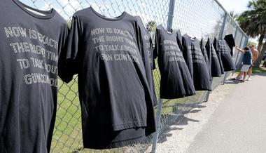 T-shirts hang on a fence near Marjory Stoneman Douglas High School in...