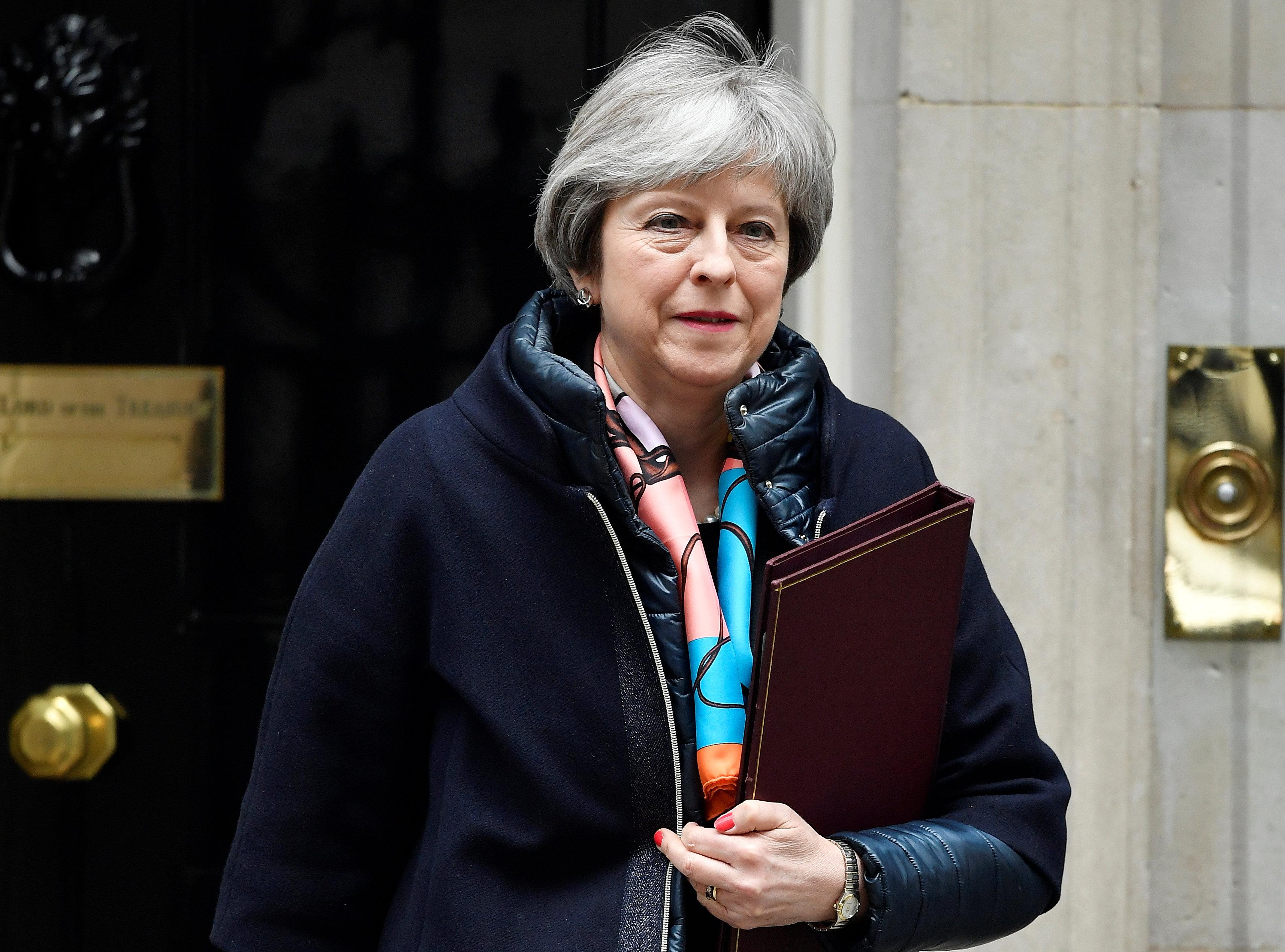 May calls on allies to act on Russian chemical programme