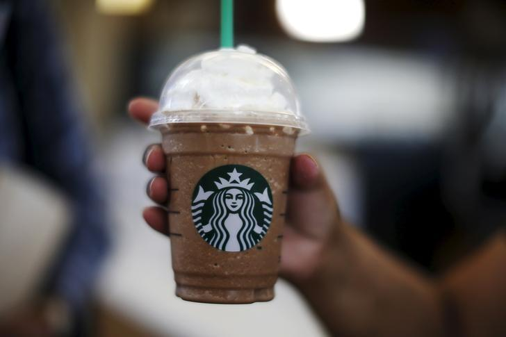 File Photo A Woman Holds Frappuccino At Starbucks Inside The Tom Bradley Terminal Lax Airport In Los Angeles California United States
