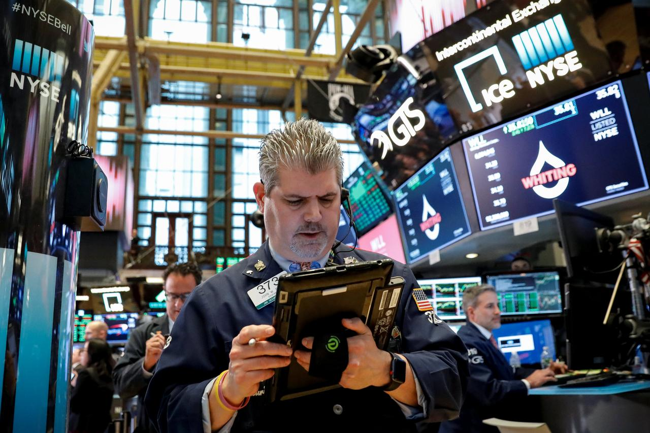 FILE PHOTO: The Dow Jones Industrial average is displayed on a screen after  the closing bell at the New York Stock Exchange, (NYSE) in New York, U.S.,  ...