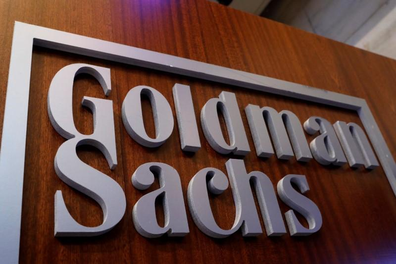 A Goldman Sachs sign is displayed inside the company's post on the floor of the New York Stock Exchange (NYSE) in New York, U.S., April 18, 2017. Brendan McDermid