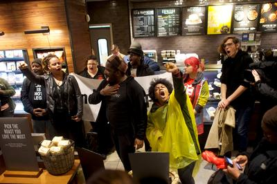 Arrest of two black men in Starbucks sparks protests