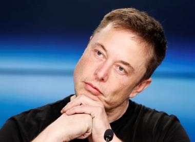 FILE PHOTO: Elon Musk at a press conference following the first launch of a...
