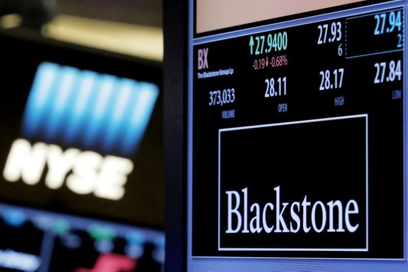 File Photo The Ticker And Trading Information For Blackstone Group Is Displayed At Post Where It Traded On Floor Of New York Stock Exchange