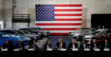 FILE PHOTO: Trump talks with auto industry leaders at the American Center...
