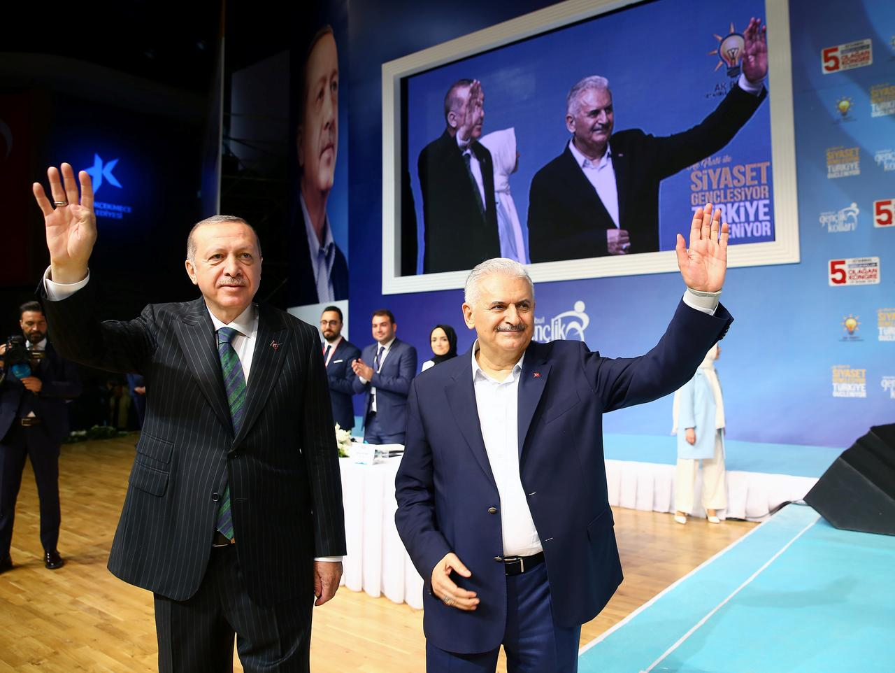 As lira tumbled turkeys prime minister won erdogan over for rate turkish president tayyip erdogan and prime minister binali yildirim greet their supporters during a meeting of the ruling ak party in istanbul turkey april m4hsunfo