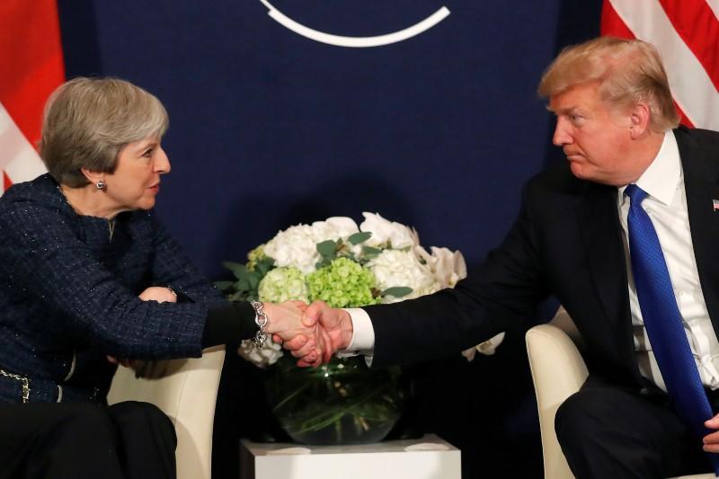 Theresa May to urge Trump to avoid London protests during UK visit:...