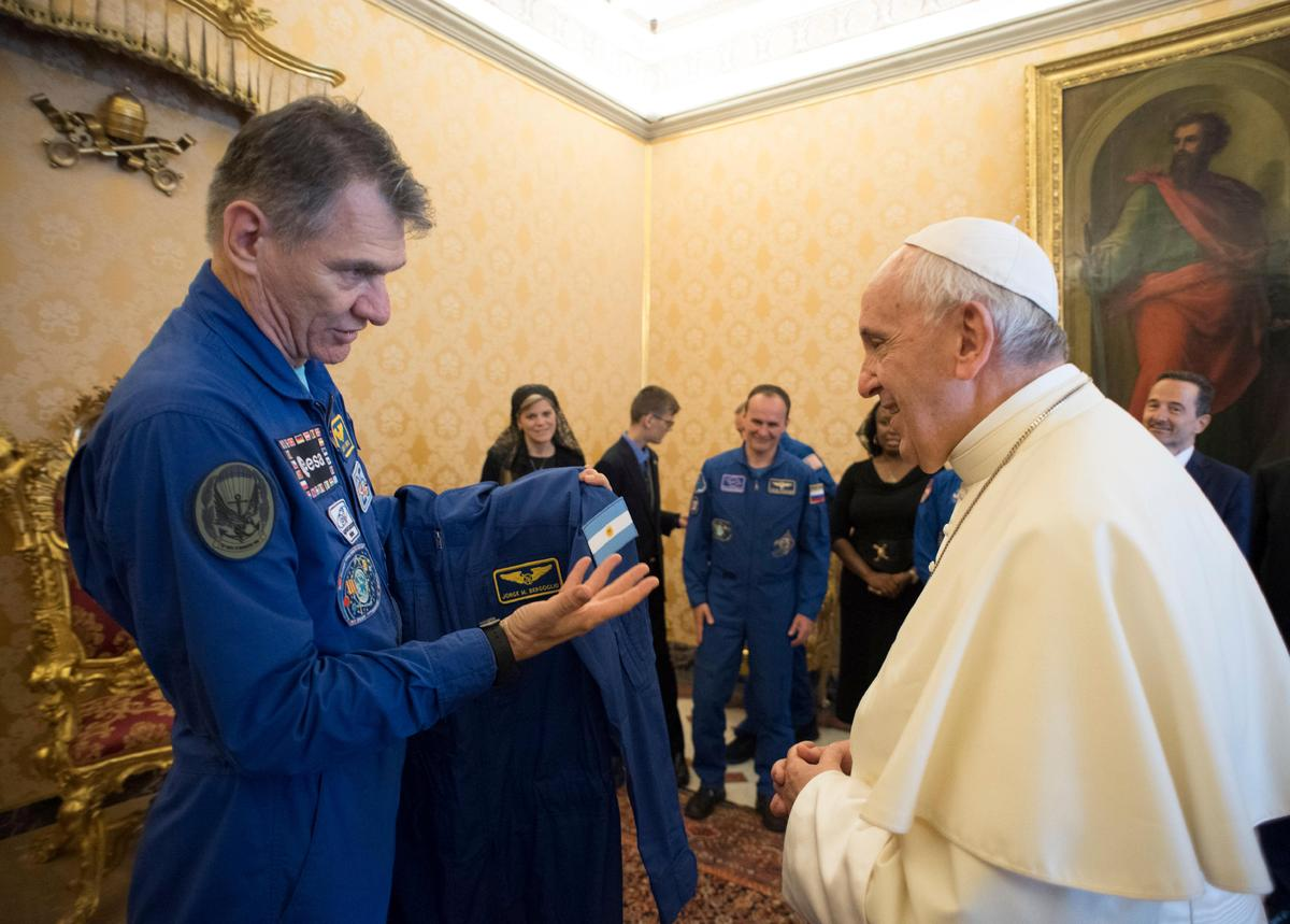Astronauts give pope personalized space suit, add white cape