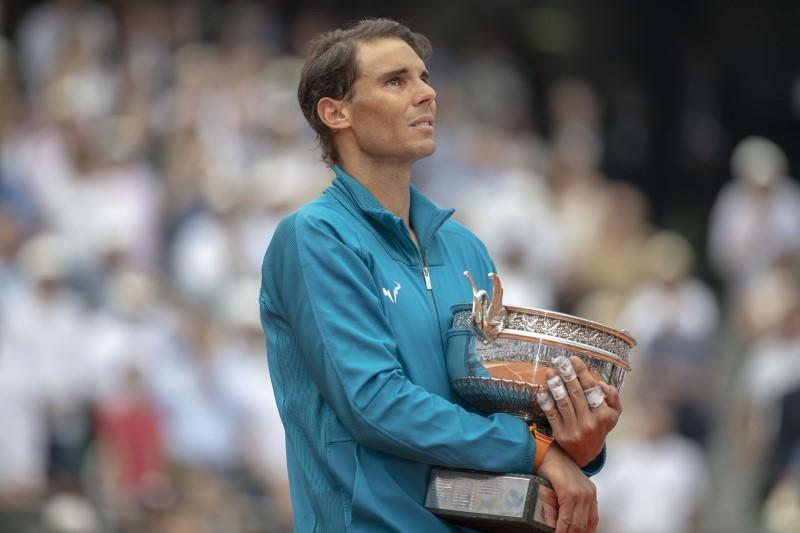 Tired Nadal withdraws from Queen's   Reuters