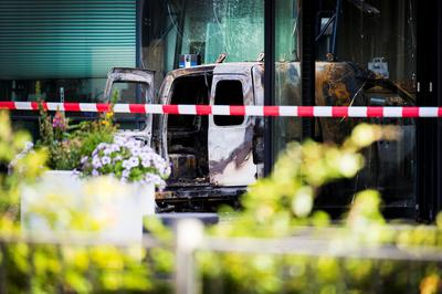 Van driven into Dutch newspaper office