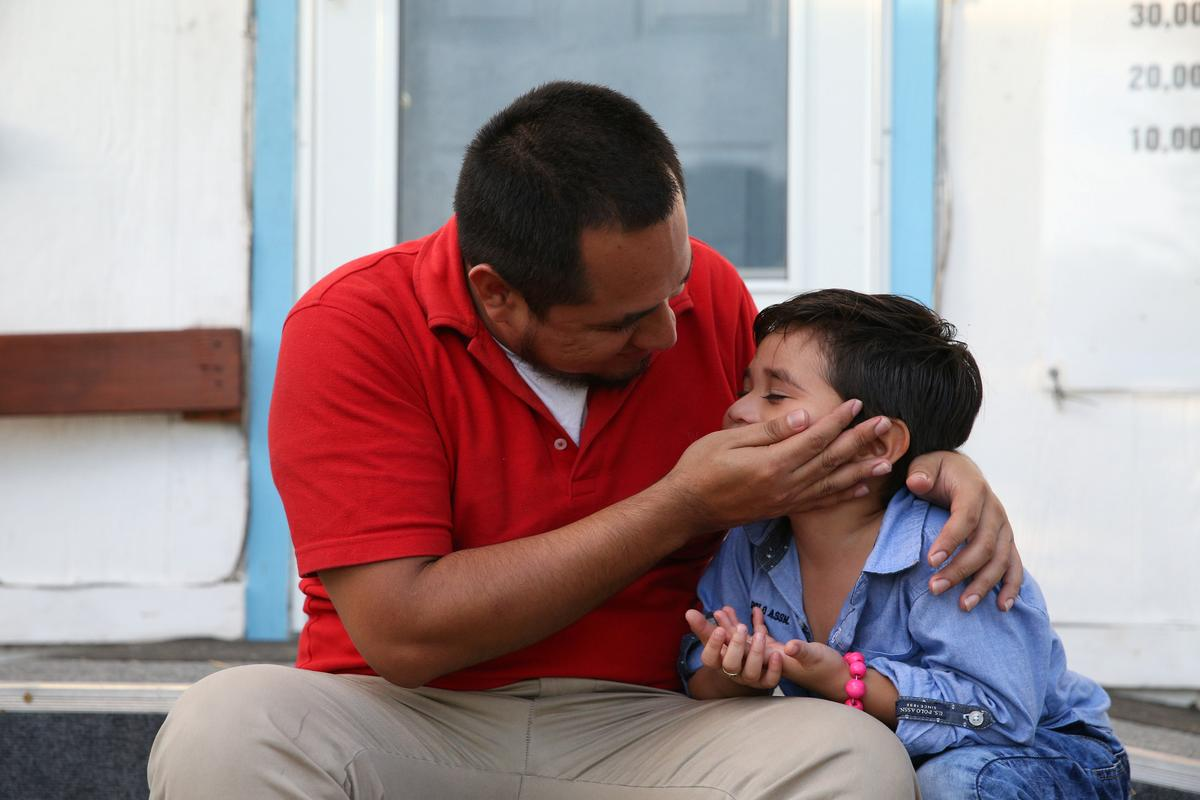 photo image 'Imagine the joy:' Father, four-year-old son reunite in U.S. immigration crisis