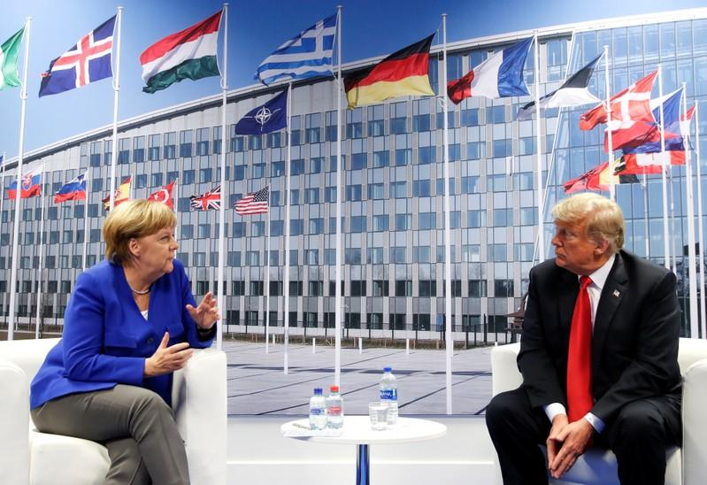 U.S. President Donald Trump and German Chancellor Angela Merkel at a meeting during the NATO summit in Brussels, July 11, 2018. Kevin Lamarque