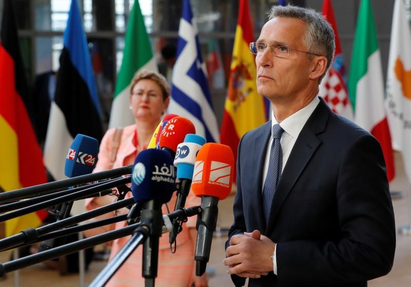 NATO Secretary-General Jens Stoltenberg addresses a media conference at an EU leaders summit in Brussels, Belgium, June 28, 2018. Yves Herman