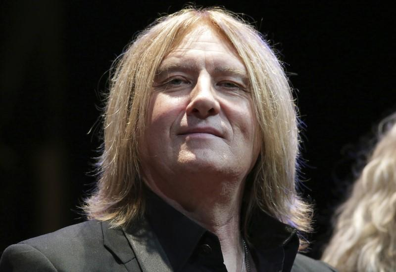d5b7c85489737 Def Leppard singer Joe Elliott sits on stage during an announcement that  Kiss and Def Leppard