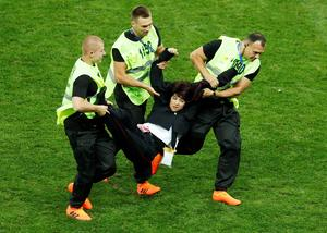 Anti-Kremlin protesters invade World Cup pitch