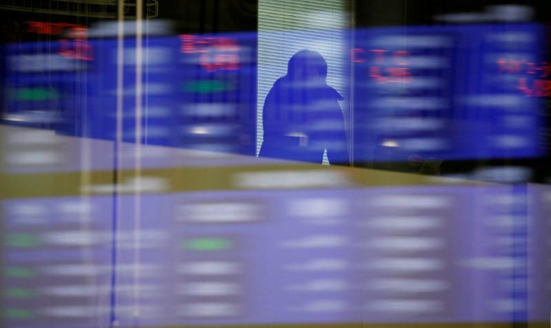 Japan shares jump as yen bows to strong dollar