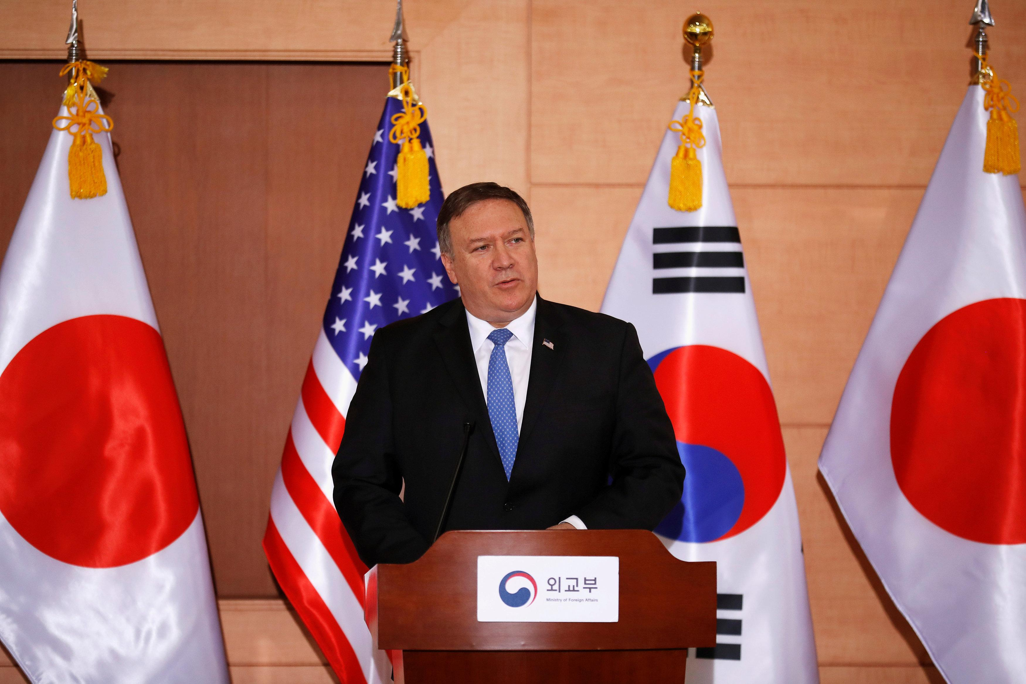 U.S. Secretary of State Mike Pompeo addresses a news conference alongside South Korean Foreign Minister Kang Kyung-wha and Japan's Foreign Minister Taro Kono at the Foreign Ministry in Seoul, South Korea June 14, 2018. Kim Hong-ji