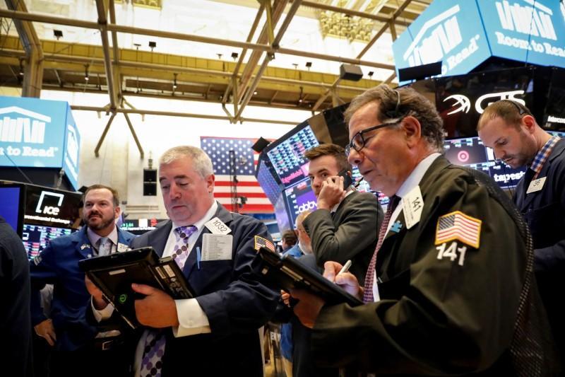 Dollar drops on Trump criticism; U.S., Europe stocks tepid | Reuters