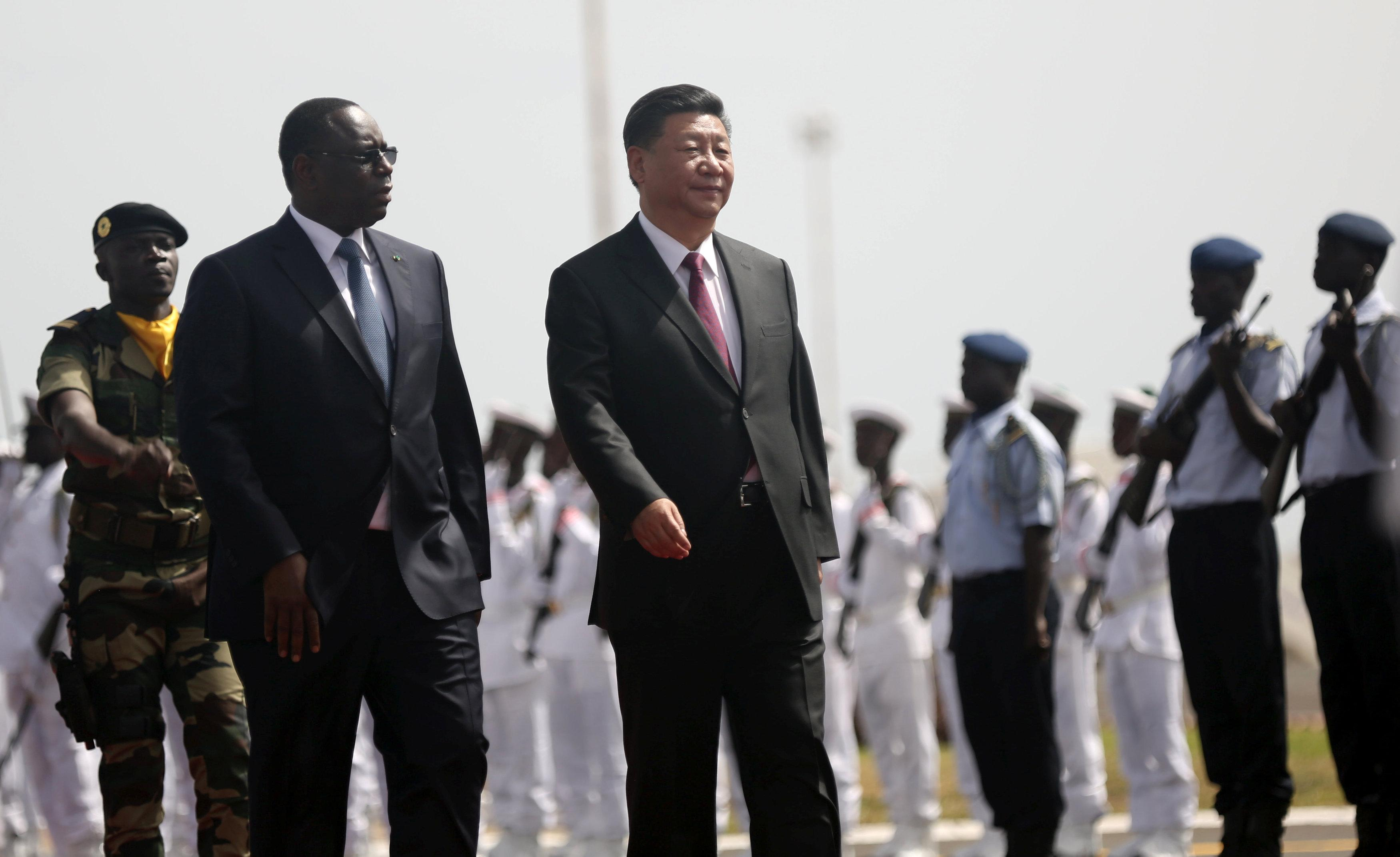 Chinese President Xi Jinping walks with Senegal's President Macky Sall after arriving at the Leopold Sedar Senghor International Airport, at the start of his visit to Dakar, Senegal July 21, 2018. Mikal McAllister