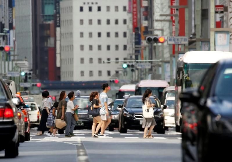 Passersby walk on a street in a heat haze during a heatwave in Tokyo, Japan July 23, 2018.  Issei Kato