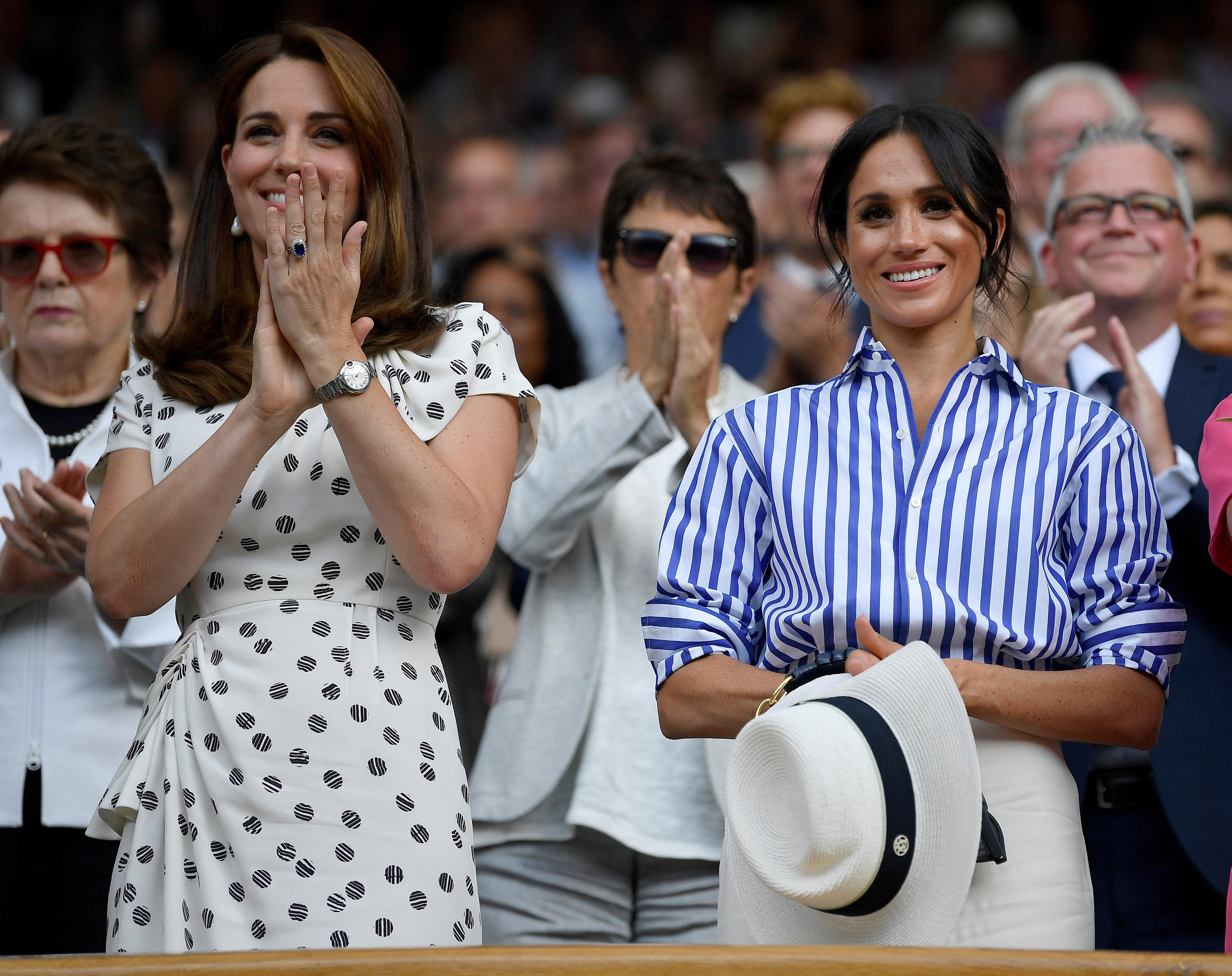 Britain's Catherine, the Duchess of Cambridge, and Meghan, the Duchess of Sussex, applaud after Germany's Angelique Kerber won the women's singles final against Serena Williams of the U.S. at Wimbledon in London, Britain, July 14, 2018. Toby Melville