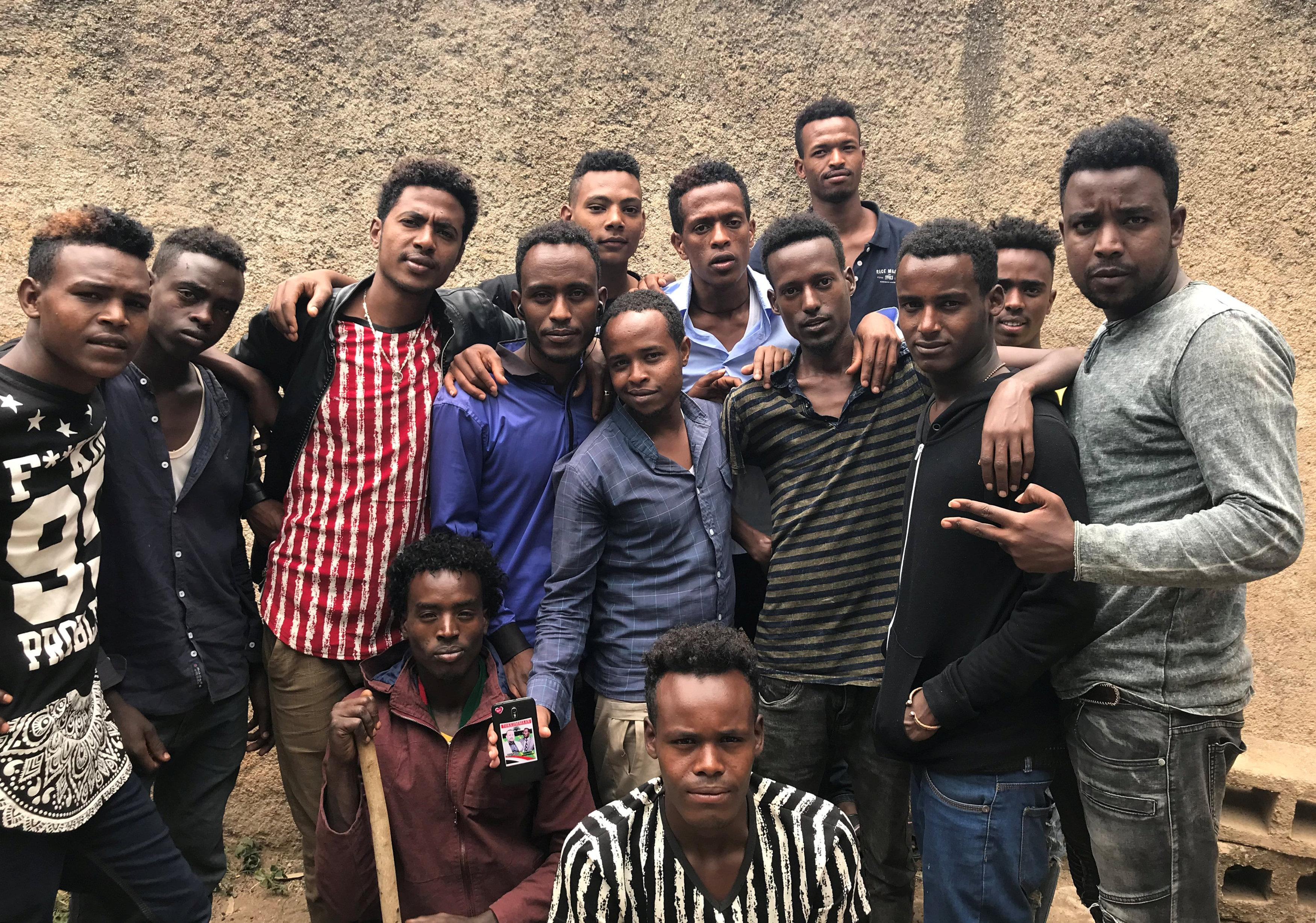 Members of the Oromo ethnic group pose for a photograph in Harar, Ethiopia July 22, 2018. Maggie Fick