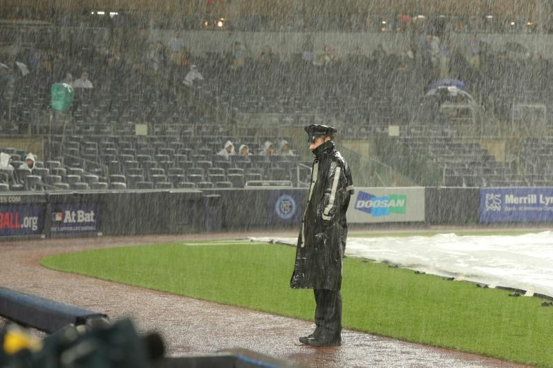 Jul 22, 2018; Bronx, NY, USA; An NYPD officer stands on the field during a rain delay before the game between the New York Yankees and the New York Mets at Yankee Stadium. Mandatory Credit: Brad Penner-USA TODAY Sports