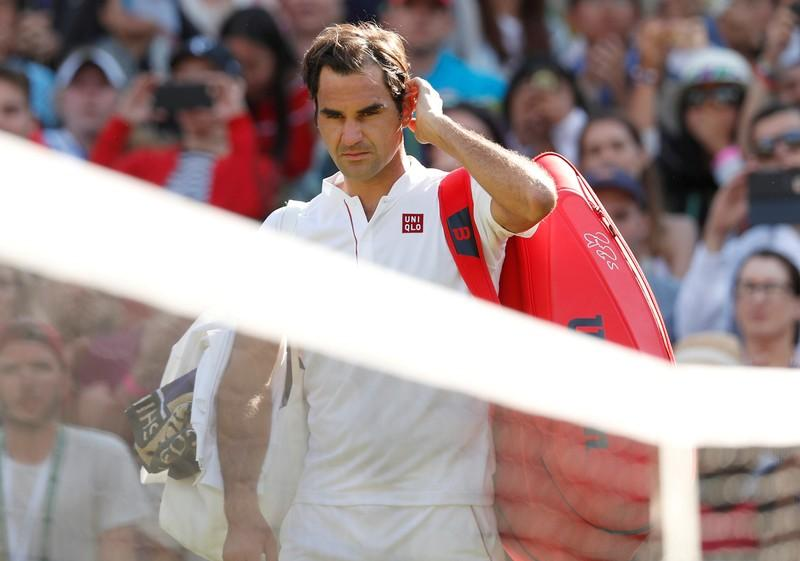 Tennis - Wimbledon - All England Lawn Tennis and Croquet Club, London, Britain - July 11, 2018. Switzerland's Roger Federer walks off court after loosing his quarter final match against South Africa's Kevin Anderson .  Andrew Boyers
