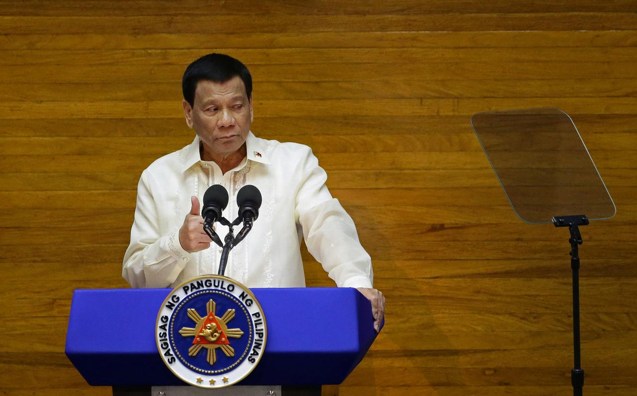 Philippine leader approves autonomy law for troubled Muslim