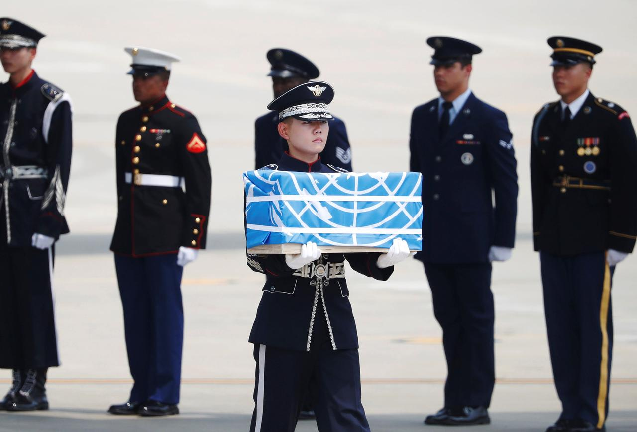 Image result for Trump thanks Kim as North Korea transfers remains of missing U.S. soldiers