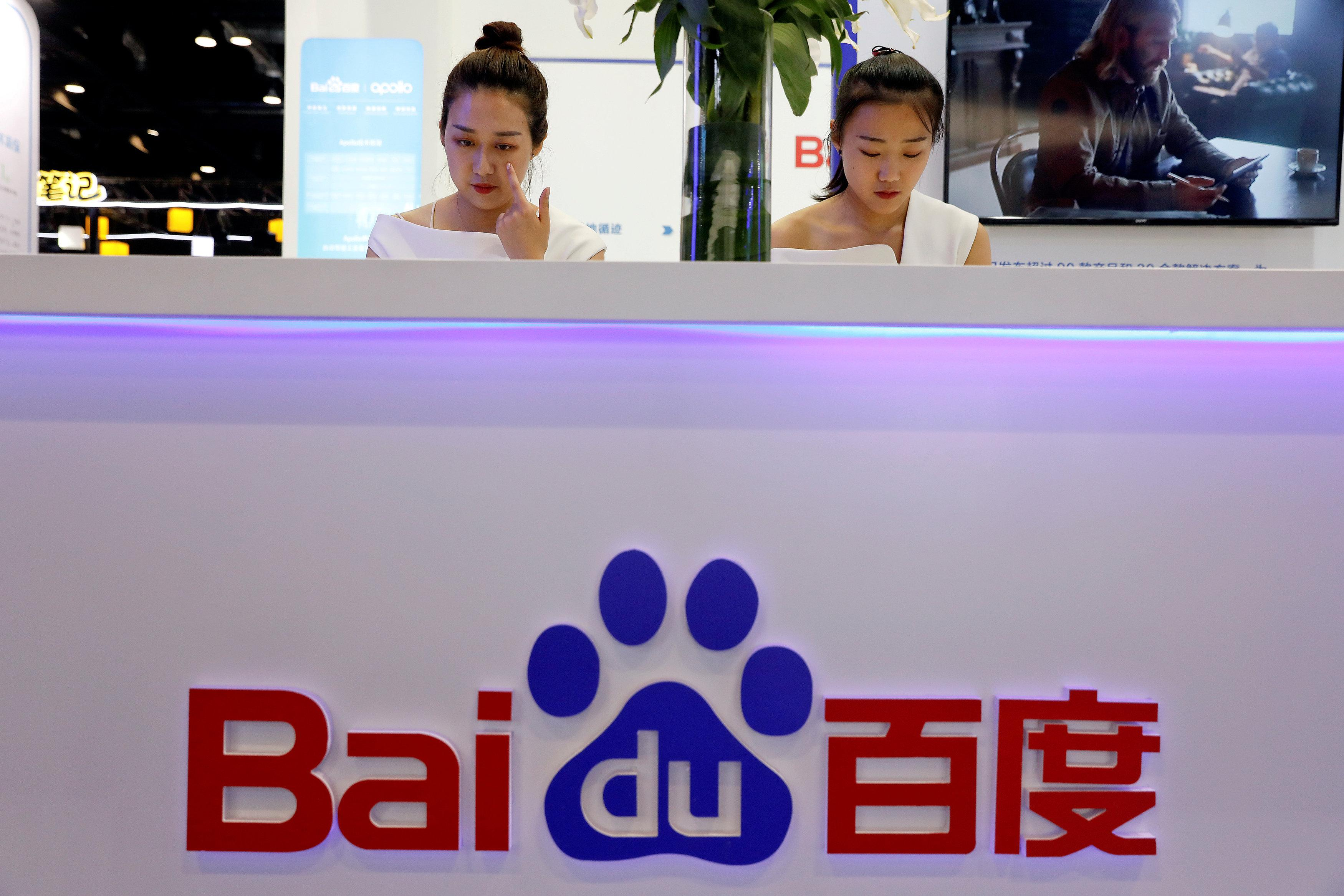Members of staff work at the Baidu booth during Global Mobile Internet Conference (GMIC) at the National Convention in Beijing, China April 27, 2018. Damir Sagolj