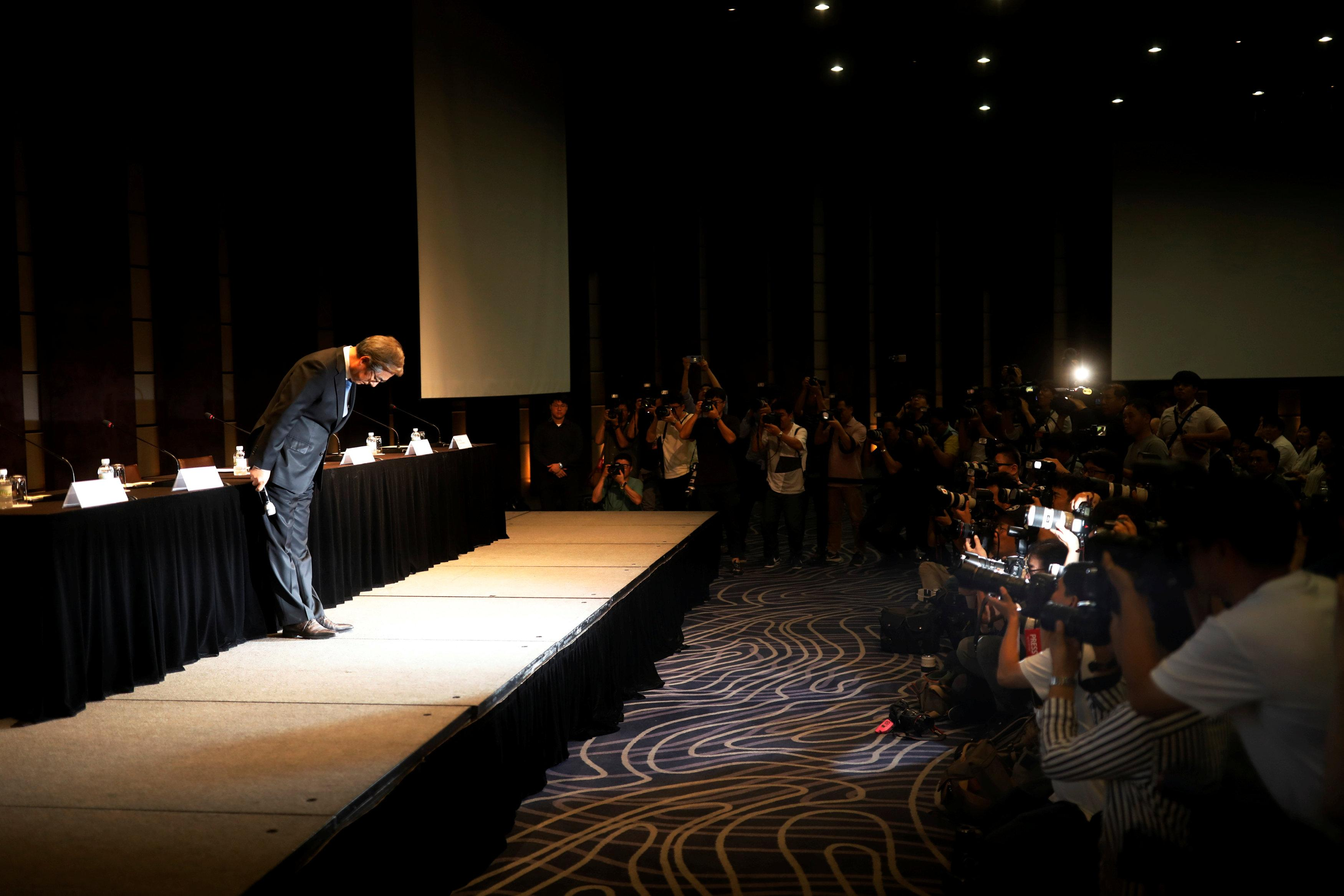 Kim Hyo-joon, chairman of BMW Korea, bows during a news conference in Seoul, South Korea, August 6, 2018.   Kim Hong-Ji