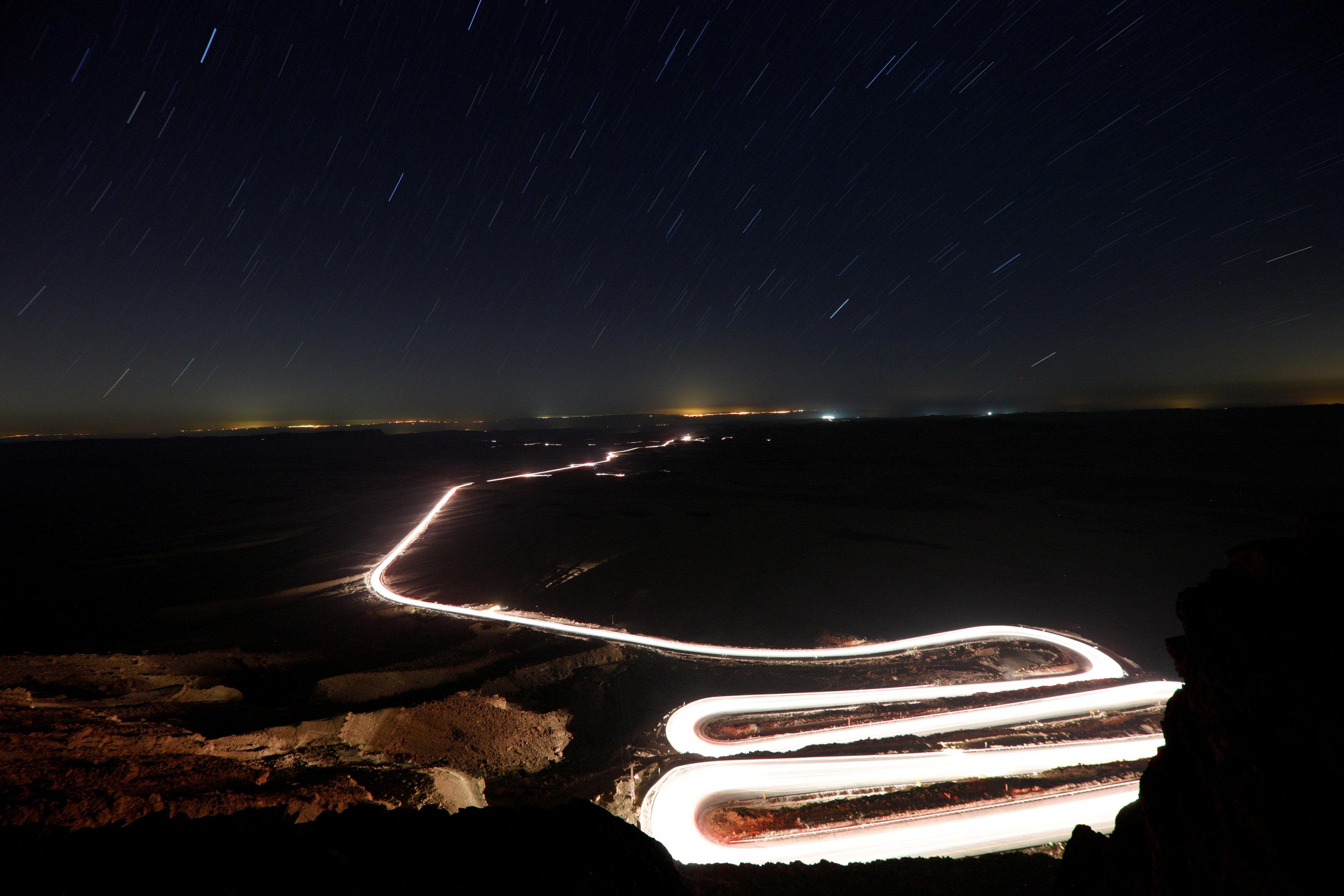 Cars drive through Ramon Crater during the Perseid meteor shower near the town of Mitzpe Ramon, southern Israel, August 12, 2018. Amir Cohen