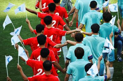 North and South Korean workers hold soccer friendly