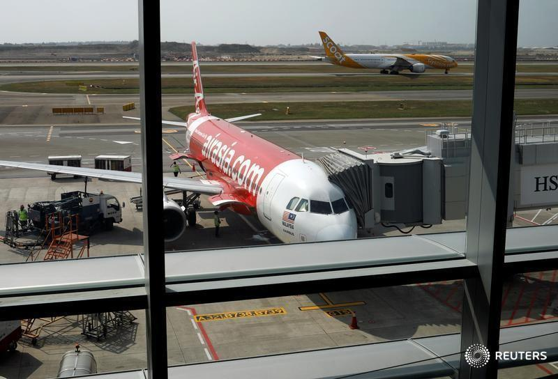 Malaysia's AirAsia divests from Expedia JV, last non-core investment