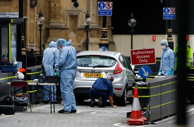 Car hits pedestrians outside UK parliament