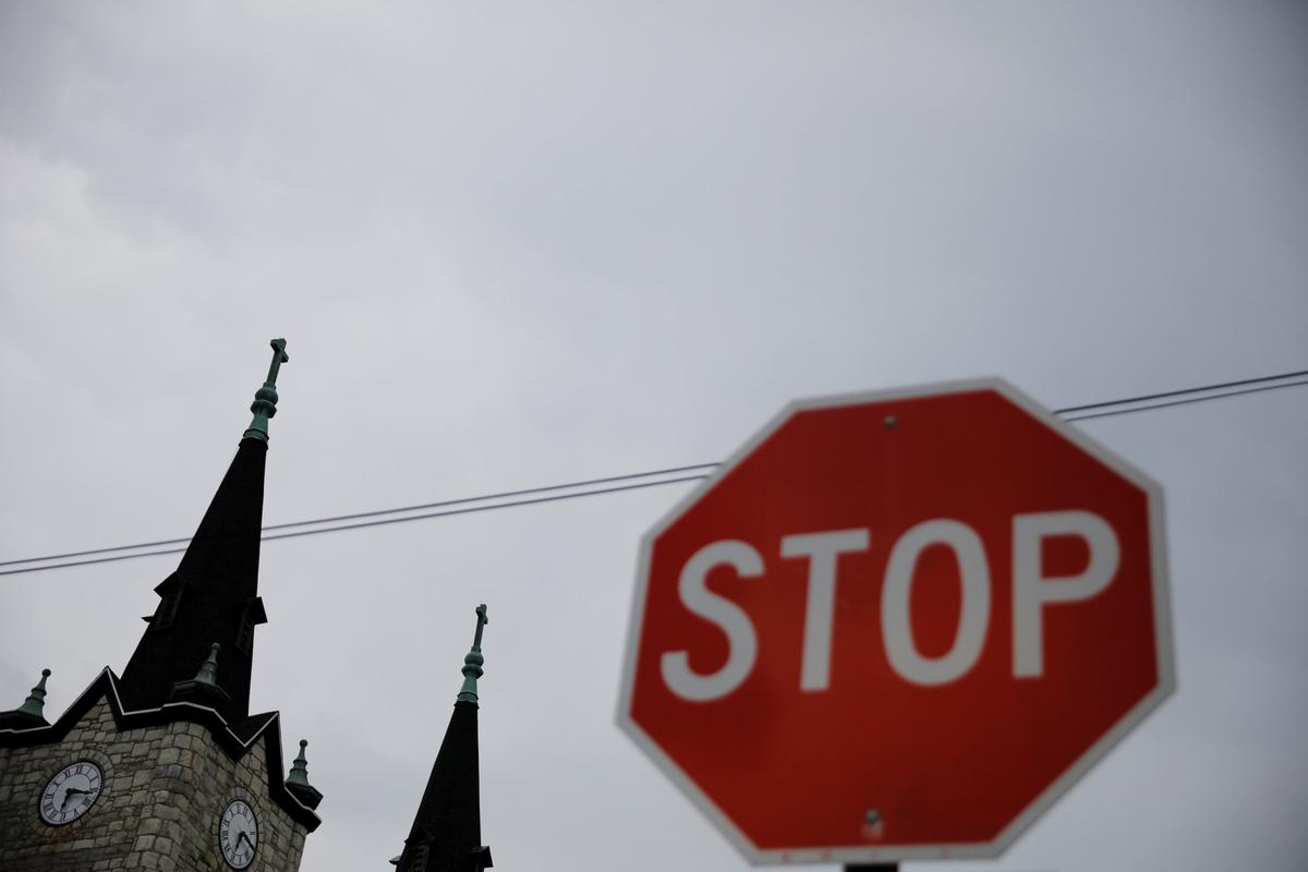 U.S. Catholics 'sickened' by sex abuse report, stand by their faith | Reuters