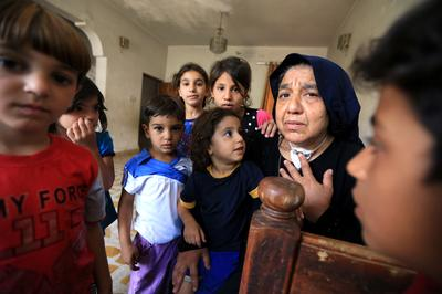 After Islamic State killed her sons, Iraqi grandmother fends for 22 children