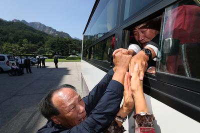 Tearful reunions for separated Korean families