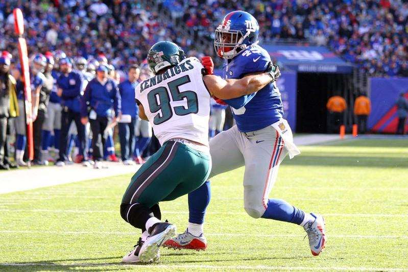 ... New York Giants tight end Will Tye (45) carries the ball to score a  touchdown as Philadelphia Eagles linebacker Mychal Kendricks (95) attempts  to tackle ... e4735749c