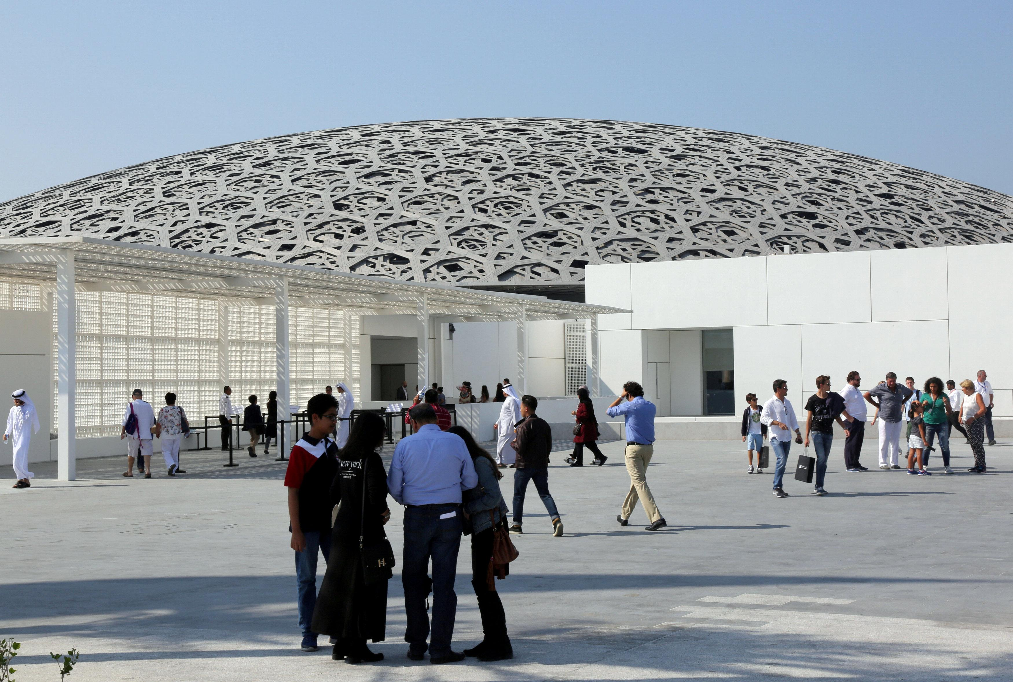 Visitors are seen at the Louvre Abu Dhabi after it was opened to public in Abu Dhabi, United Arab Emirates, November 11, 2017. Satish Kumar