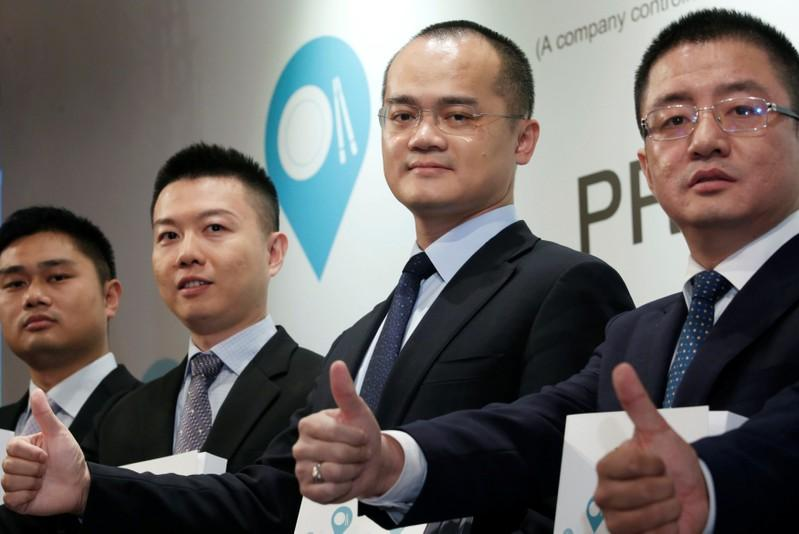 Senior Vice President Wang Puzhong, CFO and Senior Vice President Chen Shaohui, Co-founder, Chairman and Chief Executive Officer Wang Xing and Co-founder and Senior Vice President Wang Huiwen of China's Meituan Dianping, an online food delivery-to-ticketing services platform, attend a news conference on its IPO in Hong Kong, China, September 6, 2018.      Bobby Yip