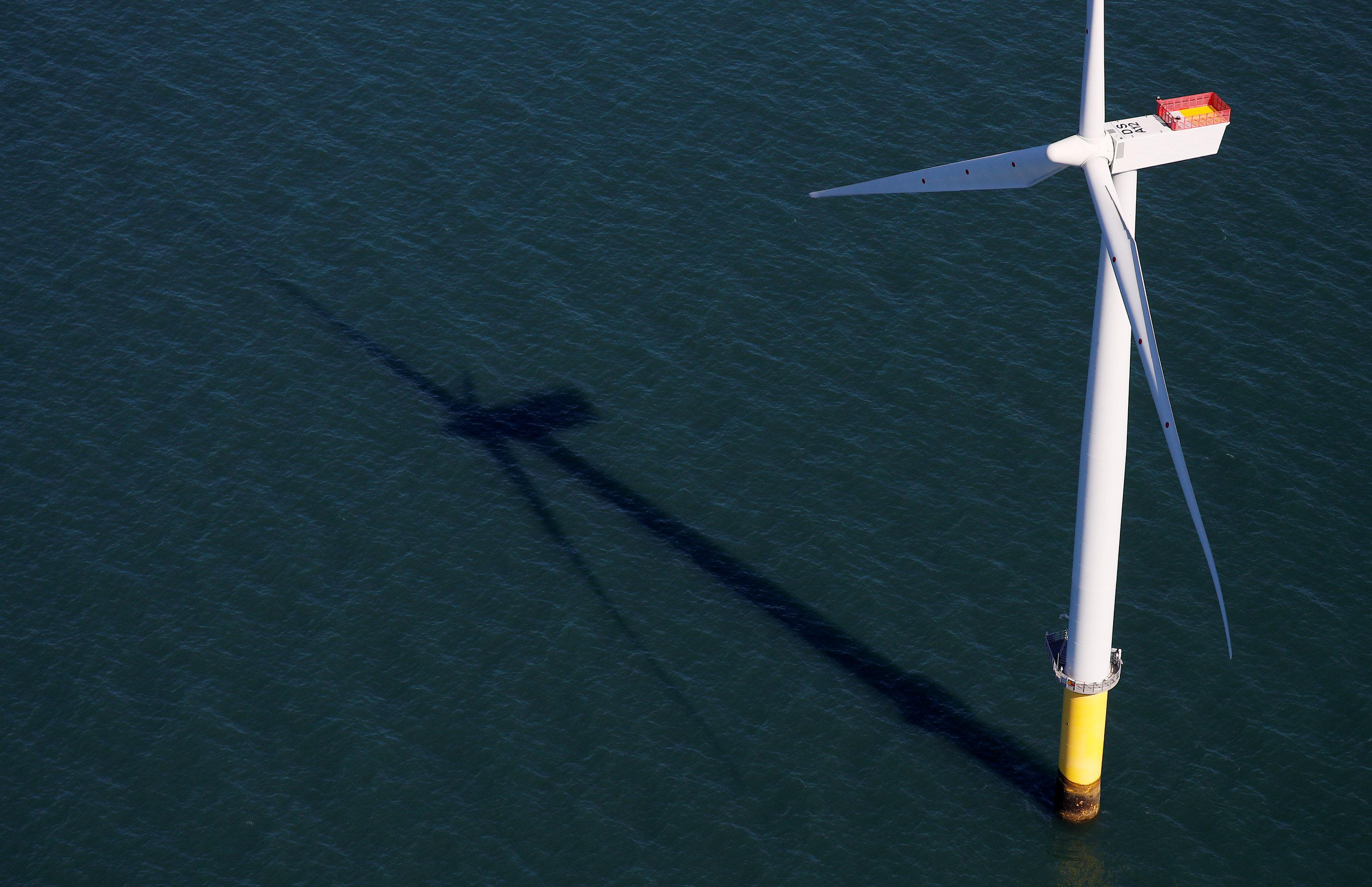 World's largest offshore wind farm opens off northwest England - Reuters