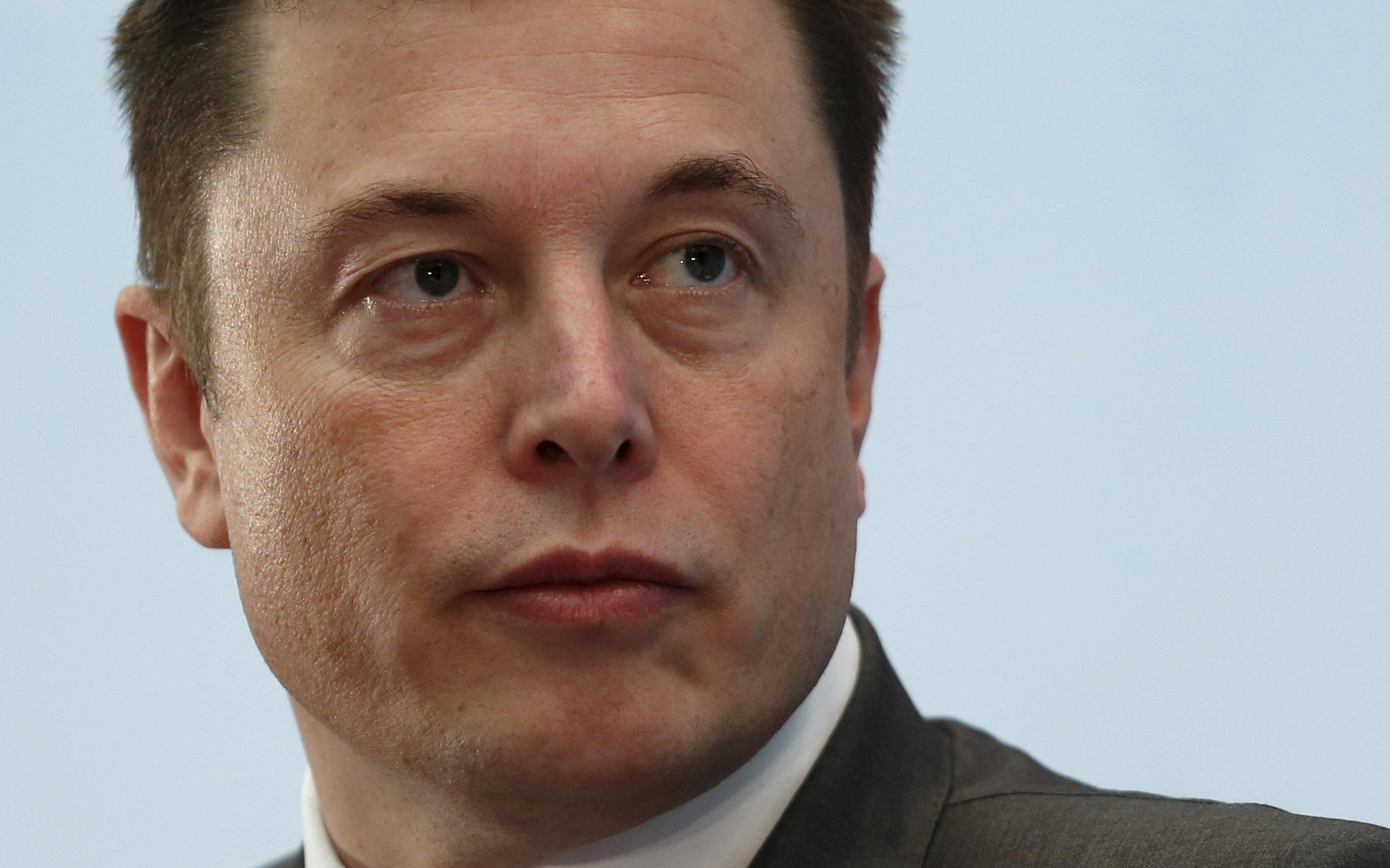 Tesla Chief Executive Elon Musk attends a forum on startups in Hong Kong, China January 26, 2016.      Bobby Yip