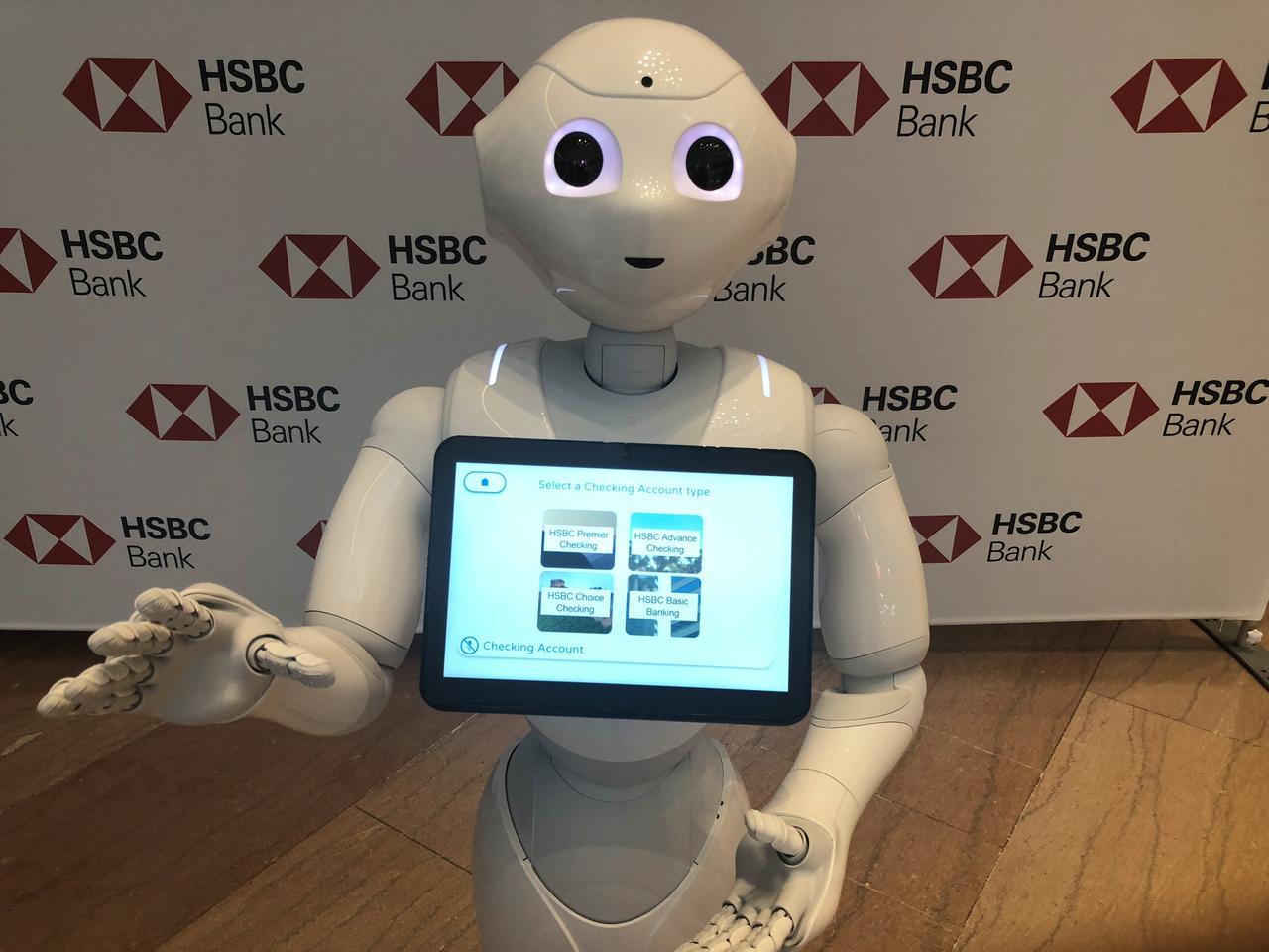 Banks turn to espressos, dancing robots to help keep U S