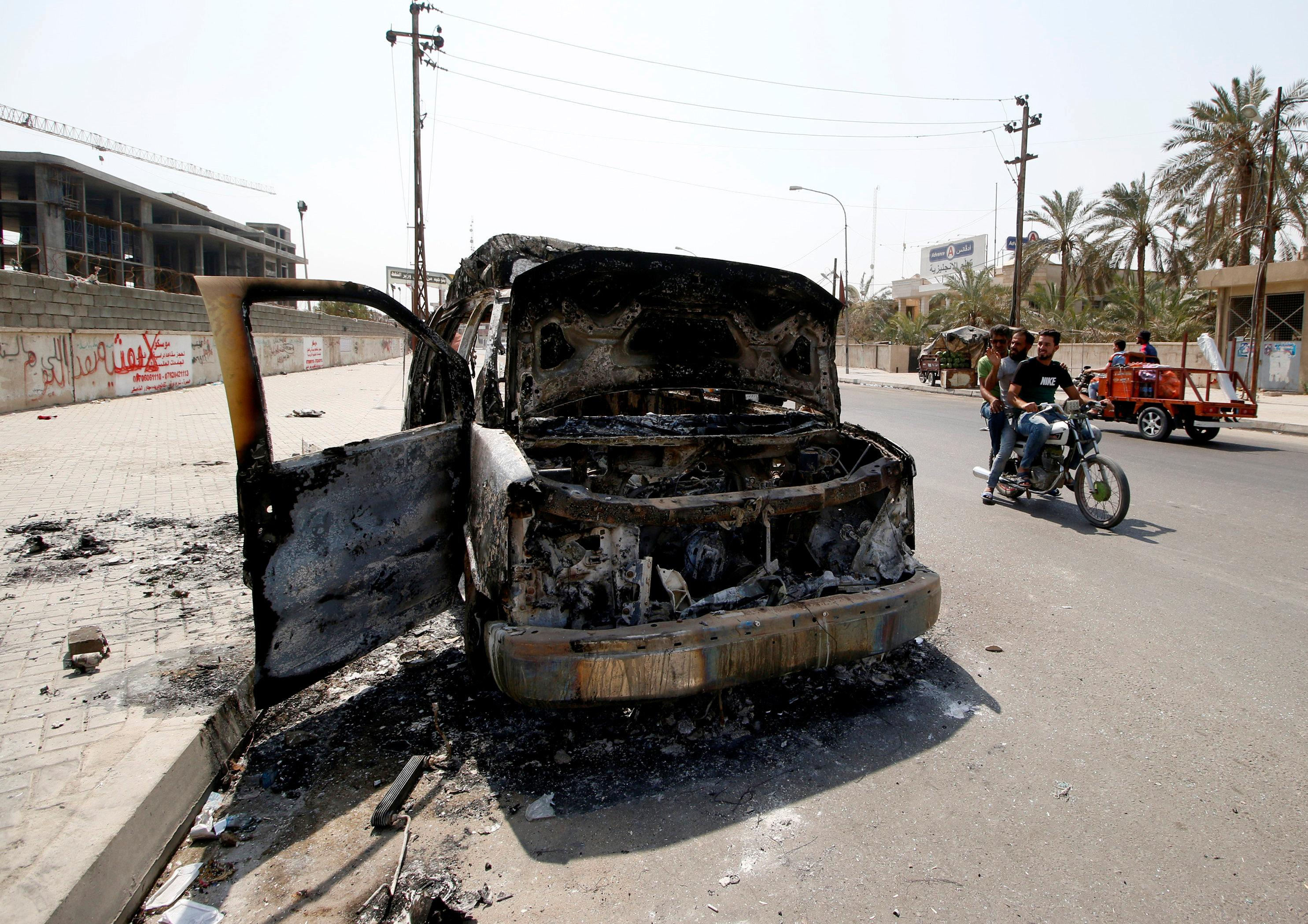 A burnt ambulance belonging to Iraq's Popular Mobilization Forces, burned during the protests, is seen in the street in Basra, Iraq September 8, 2018. Essam al-Sudani